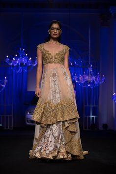 Gold net layered lehnga by Falguni & Shane Peacock. More here: http://www.indianweddingsite.com/bmw-india-bridal-fashion-week-ibfw-2014-falguni-shane-peacock-show/