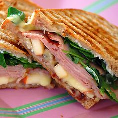 jambon panini(~grilled w.brie, thick sliced ham, thin sliced apples, baby spinach, & dijon on french toast slices)