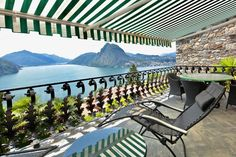 Lake Lugano inRuvigliana, Switzerland, is the stunning backdrop to this colorful Mediterranean-style estate. Sliding-glass doors make it easy to open the house to the outdoors, while a balcony overlooking the lake makes for a perfect spot for relaxing or dining alfresco.