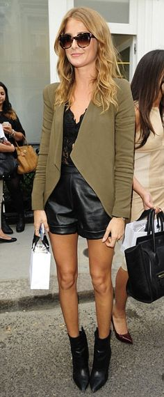 The new designer completed her look with a khaki green jacket and ankle boots on Friday