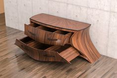 """""""Commodia"""" - Eckhard Beger, Switzerland. Commodia is a chest of drawers based on organic surfaces and shapes. Its outline is emphasized by the contrast between the wood colour of its surfaces and its edges."""