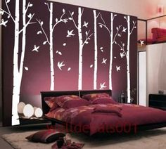 Whimsical bedroom <3.  love the trees.. not so much the bed