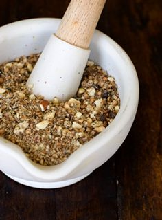 Dukkah  is a crumbly mixture of nuts, herbs, and seeds. Although its origin is Egyptian, we first encountered it in South Australia, at a riotous lunch hosted at St. Hallets winery. It was laid out in a dish in the middle of the table, and our Australian hosts instructed us to dip our bread into olive oil (also in a small dish on the table), and then into the dukkah.