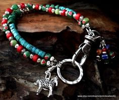 Gorgeous Sundance style bracelet. Adorable Sterling Silver horse charm. The red Coral and blue Turquoise look beautiful together! I love the simplicity of this double strand bracelet. The silver beads are Hill Tribe Silver from Thailand. I love using Hill Tribes Silver in my designs. All my jewelry designs are one of a kind. This bracelet also has handmade charms. I really enjoy making these quirky little charms. They are so much fun! This bracelet measures 8 from end to end when unclasped…
