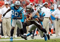 : Lineback Jon Beason #52 of the Carolina Panthers tackles tightend Dallas Clark #44 of the Tampa Bay Buccaneers after a reception during the game at Raymond James Stadium on September 9, 2012 in Tampa, Florida. (Photo by J. Meric/Getty Images)