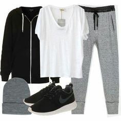 Playera balnca, chamarra negra, pantalon gris claro, tenis negros adidas