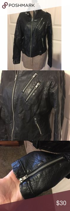 Maurices Black Pleather Motocycle Jacket Medium Good used condition Maurices jacket. This is a pleater material. It has two zippered pockets on the front and the two zippered pocket on the breast can hold smaller items. This jacket is in good condition other than fading of the material and a bit of wrinkling, most of the wrinkling being in the back. Sized medium. Shell: Face: 100% polyurethane Backing: 100% viscose Lining: 100% polyester. Measurements laid flat: Armpit to armpit: about 19…