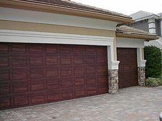 Paint garage door to look like a wood garage door. And add nice handles?  www.facebook.com/NewEraModulars www.neweramodulars.com