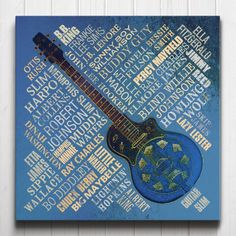 Blues Legends Canvas - A typographic tribute to the great Blues musicians of all time. The artwork features a collage of names surrounding a stylised guitar centrepiece.