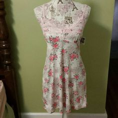Jessica Simpson Nightgown NWT. White with pink and green floral design slip like nightgown, pink lace detailing on v-neck line with center pink bow, adjustable straps, 94% poly 6% spandex. Jessica Simpson Intimates & Sleepwear