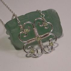 A clover for St Patrick's day. It's tiny, only about an inch across, and it's on a super thin delicate chain Wire Jewelry Designs, Metal Jewelry, Jewelry Crafts, Jewelry Art, Beaded Jewelry, Wire Pendant, Wire Wrapped Pendant, Wire Wrapped Jewelry, Pendant Jewelry