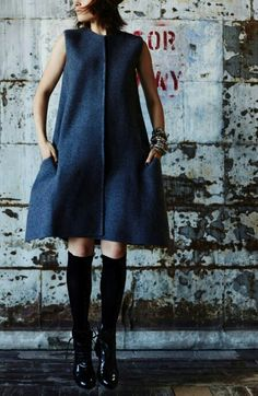 A line dress with knee high black sock and lace up black shoes