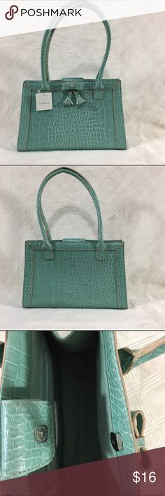 NWT Small turquoise Liz Claiborne purse Small turquoise snakeskin design Liz Claiborne purse. Bow in front. two straps. One zipper pocket inside. Snap closure.  New with tags. Liz Claiborne Bags Shoulder Bags