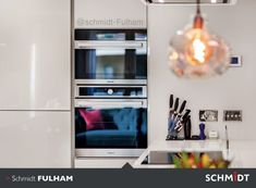 Integrated appliances allow the customer freedom of movement around this sleek, modern kitchen.