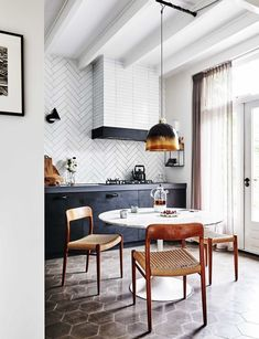 black and white kitchen and eat-in dining room | modern terracotta floors