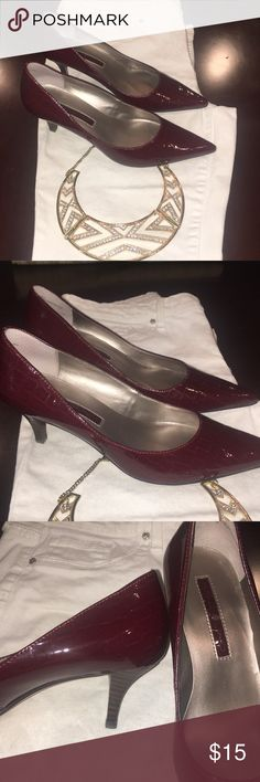 Bandolino Red leather heels, size 6! Very chic red leather heels. The red is a perfect ruby color with a snake like texture. The heel is only an 1.5 inches high. Super comfortable for work or walking all day! Gently used and loved! Bandolino Shoes Heels