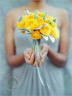 yellow ranunculus bouquet- leaves and ribbon
