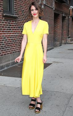 Lizzy Caplan in a yellow short-sleeve Roksanda midi dress