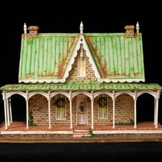 This house looks so real that you might forget it's less than a foot tall and edible. Its builder crafted the white decorative trim using rolled-out fondant and an X-Acto knife, and created the intricate brickwork with a small paintbrush—and a steady hand.
