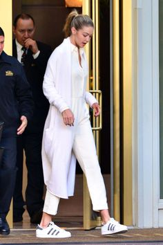 Gigi Hadid looked so stylish in an all white outfit and Adidas Superstars.
