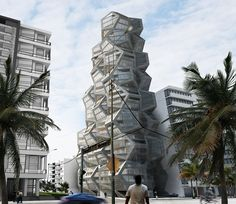 based on two platonic shapes, the cube and the dodecahedron, a unique housing tower is proposed in peru over a public plaza.