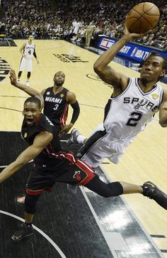 Kawhi Leonard  shoots on Chris Bosh  during the second half at Game 5 of the 2013 NBA Finals basketball series