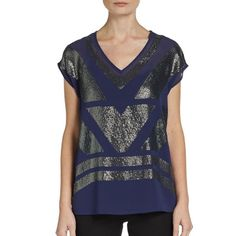 Saks Fifth Avenue Sequin Top in Eggplant Black label from Saks Fifth Avenue. Flowy purple top with silver sequin design on the front and semi sheer back. I wear it with a black bra but you can also put a tank under neath. Runs true to size but could fit an xs or a medium if you want it more or less Flowy. Perfect condition. Ships same day from a smoke free home! Saks Fifth Avenue Tops Blouses