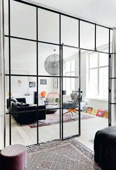 Glass room dividers / elle decoration UK -- This room divider creates definition without obstructing views and light - an important consideration if you have a small, dimly lit space.