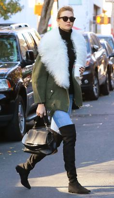 Karlie Kloss in a shearling coat, jeans and thigh-high boots - click through to see more celebrity winter outfits