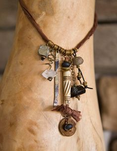 One of My Tribe necklace: bone, crystal, pyrite, hammered brass, black spinel, recycled sari silk