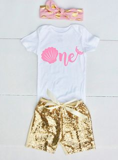 This 1st Birthday Baby Girl Outfit is too cute to celebrate her big first birthday! Your little one will get oohs and ahhs with this adorable baby outfit! Makes a great baby gift! This Listing is for any of the following: Bodysuit Pink & Gold Polka Dot Bow Headband Gold Sequin Shorts Set of 2 w/Bow Includes: Bodysuit Pink & Gold Polka Dot Bow Headband Set of 2 w/Shorts Includes: Bodysuit Gold Sequin Shorts Set of 3 Includes: Bodysuit Pink & Gold Polka Dot Bow Headban...
