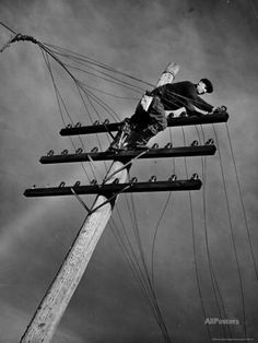 NY Telephone Co. Lineman Wallace Burdick Repairs Telephone Lines Between Valhalla and Brewster Photographic Print by Margaret Bourke-White at AllPosters.com-my dad did this in Texas in 1940s