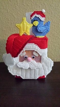 Santa tissue box cover that from plastic canvas.