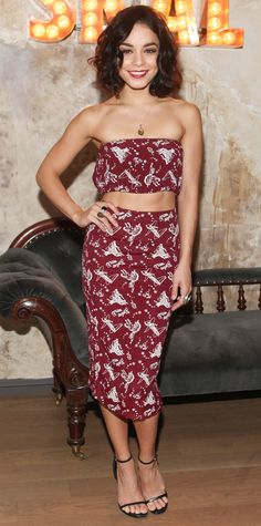 Vanessa Hudgens showed off her abs in matching burgundy printed separates, offsetting the risque bandeau top with a rather demure midi-length pencil skirt. An amber pendant, a selection of gemstone cocktail rings, and delicate black sandals completed her look.