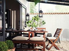 Hang IKEA BORRBY Lanterns To Create An Indoor/outdoor Lighting Fixture Over  The Table.