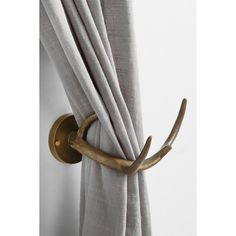 Magical Thinking Antler Curtain Tie-Back (21 AUD) ❤ liked on Polyvore featuring home, home decor, window treatments, curtain rods, antler curtain rod, antler home decor, rustic window treatments, antler curtain tie back and bronze drapery rod
