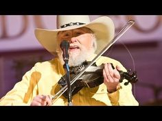 """Charlie Daniels Band -""""Devil Went Down to Georgia"""" Live at the Grand Ole Opry.  Now this is good music. :)"""