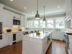 white kitchen cabinets with white marble countertops - modern interior paint colors