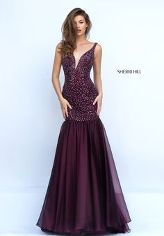 Delight in the ebullient sparkle of the Sherri Hill 11324 fit and flare satin prom dress. The sleeveless dropped waist bodice is stunningly embellished with colored beads and showcases a curved plunging V-neckline with sheer modesty inset. Beaded straps span the shoulders and frame the deep V-back. The skirt flows in softly gathered layers from the low waist and finishes in a sleek sweep train.
