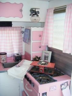 Pink stove   vintage trailer = perfection.