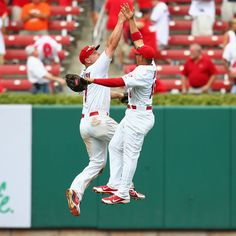 Matt Holliday and Jon Jay celebrate after a 7-4 victory over the Dodgers