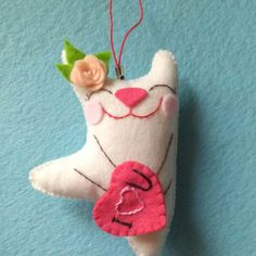 This Funny Kitten is looking for its owner. Felt hand embroidered key ring will be a great Valentines gift for a loved one and put a smile on face for a long time!!! Size: 9,5 cm x 6,5 cm (3.76 x 2.55) Gift box: 10cm x 8.5cm (3.94 x 3.35) Felt pendant is made of felt and filled with soft holofiber to create volume. Hand applique. Bead embroidery. The Kitty is so soft and pleasant to the touch that you will fall in love at first touch. But I am sure that you have already loved it!  Your…