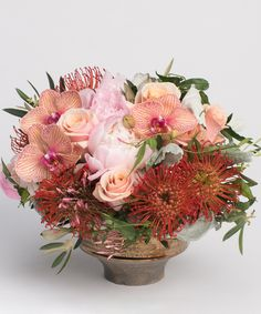 Garden Rouge - This fun and funky arrangement of all coral and blush tones is designed in a unique bronze ceramic container. #peonies #mothersday #flowers