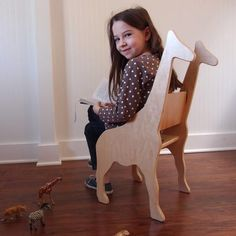 "CHILD'S GIRAFFE ANIMAL CHAIR- your choice of color by Paloma's Nest This chair ships fully assembled, ready to enjoy straight from the box. Each piece is sold separately. Dimensions (due to handcrafting, all sizes are approximate): Giraffe Chair: 17"" L x 28"" H x 13.5"" W. $248"