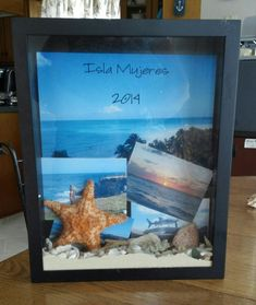 Vacation shadow box.   A couple of my favorite pictures and some shells and sand i collected from the beaches we visited