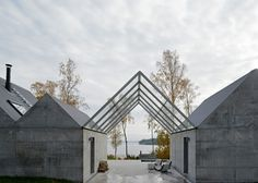 A row of raw concrete gables give a zig-zagging profile to this summer house by Swedish studio Tham & Videgård Arkitekter on an island in the Stockholm archipelago