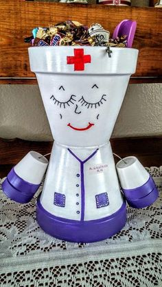 This nurse is a great planter for any Nurse. Body is made with 6 inch pots, and smaller for arms and legs, it will be 12 inches tall. You may choose second color besides white other wise it will be purple.
