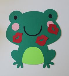 Pin the Kiss  on the Frog Game. $12.00, via Etsy.    Bet you could make your own...with felt or use paper and laminate and or use paper and let kids wear lipstick and leave a kissprint on the frog