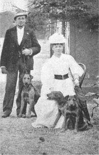 Couple with Three Airedale Terriers c. 1910