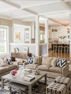 """Paint Color is San Antonio Gray AC-29 by Benjamin Moore.  The fabric for the blue and white pillows is Quadrille purchased from Furn & Co., and the fabric for the other pillows is Lee Jofa. The rug was made by """"Niba Rugs"""" and the console table was purchased from Baker."""